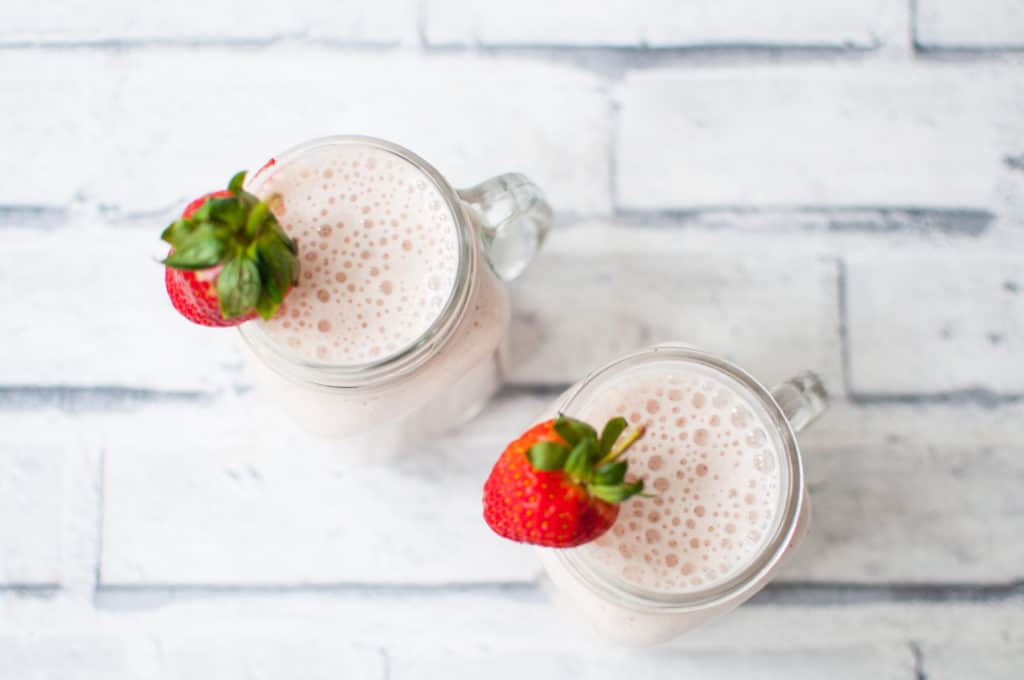 Clean eating strawberry and banana smoothie recipe made with only 4 simple ingredients. Loved by all family, it is dairy free, gluten free and sugar free.