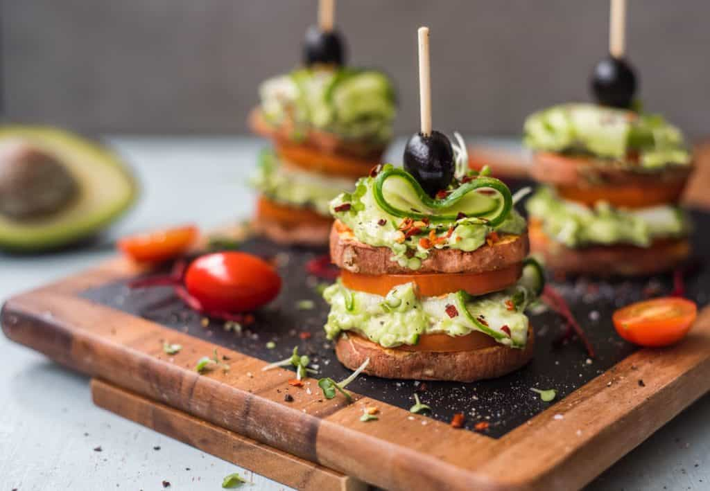 Healthy, loaded sweet potato stacks recipe with creamy avocado, beef tomatoes, ribbons of cucumber and loads of delicious spices. An easy, healthy side dish, appetizer, party food or a light meal! Paleo, Vegan and Whole30 compliant, family approved!
