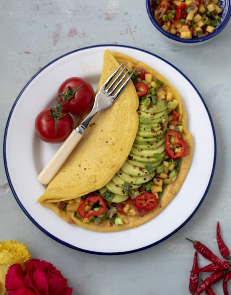 This delicious Chickpea Omelette with Avocado and Mango Salsa recipe omelette is a brilliant savoury breakfast idea, quick & light lunch or the perfect weekend brunch dish. It's vegan, gluten, nut and dairy free too! #veganrecipes #dairyfreerecipes #healthyfoods #wholefoods #fastfreshfood