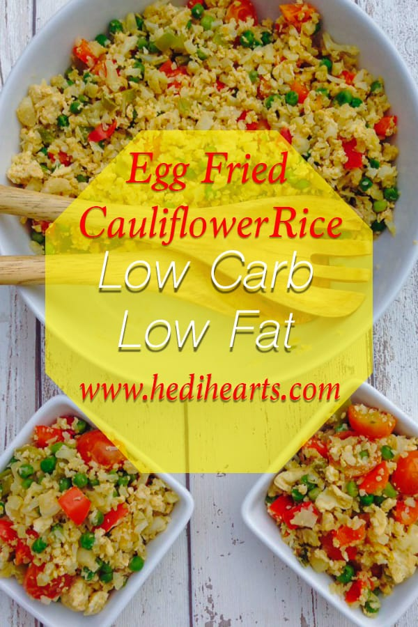 This easy egg fried cauliflower rice recipe made with simple ingredients is a crowd-pleasing, low-calorie and low fat midweek lunch or dinner idea. And it doesn't taste like cauliflower at all! #vegetarian #healthydinner #eggfriedrice #cauliflowerrice #healthyrecipes #veggierecipes