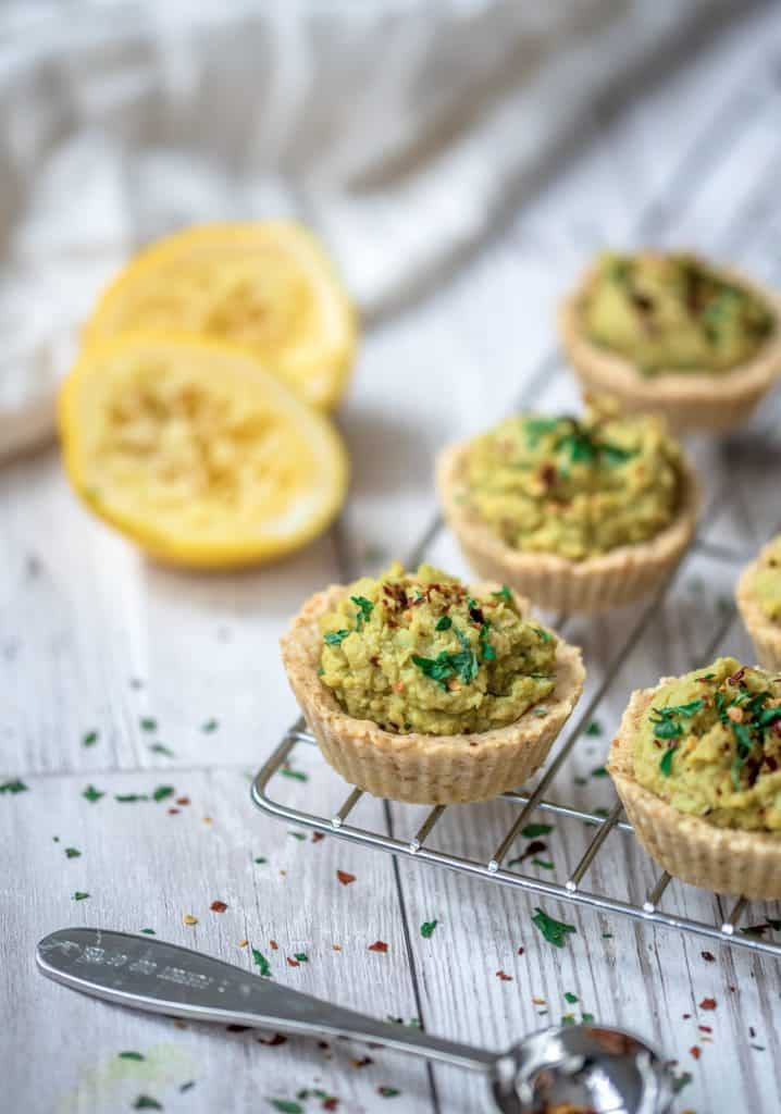 Savoury easy party tartlets recipe served with lush avocado hummus. The perfect dairy free and gluten free party starter or delicious snack for the family! #glutenfree #partysnacks #vegansnacks #avocadohummus #easyrecipes #healthyfood