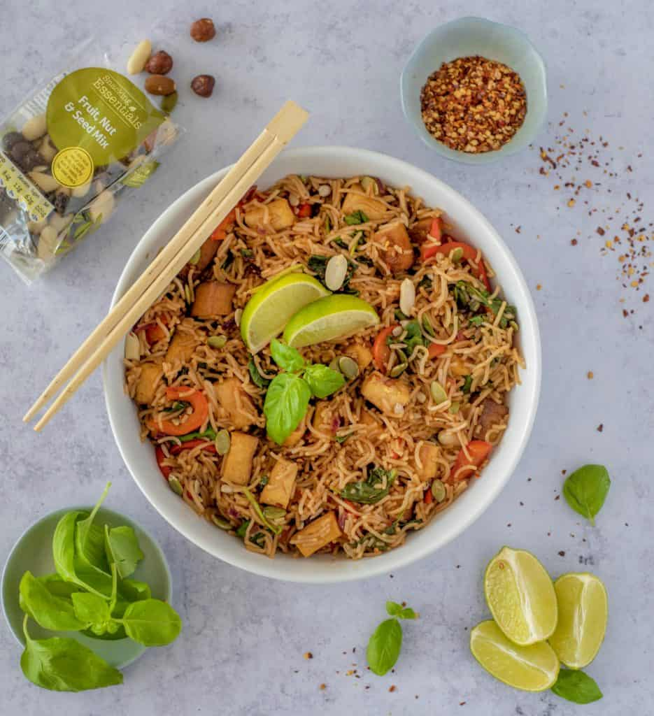 Clean eating Rice Noodle Bowl with Crispy Tofu recipe which is fresh, quick, satisfying, lots of vegetables, and plenty of protein all ready in 30 minutes. Vegan and gluten free too! #healthyeatingrecipes #healthydinnerideas #vegandinners #healthyvegan #easyhealthyrecipes # cleaneatingrecipes #cleaneating #glutenfreedinner
