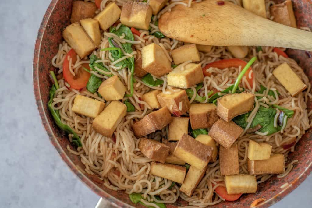 Healthy Rice Noodle Bowl with Crispy Tofu recipe which is fresh, quick, satisfying, lots of vegetables, and plenty of protein all ready in 30 minutes. Vegan and gluten free too! #healthyeatingrecipes #healthydinnerideas #vegandinners #healthyvegan #easyhealthyrecipes # cleaneatingrecipes #cleaneating #glutenfreedinner