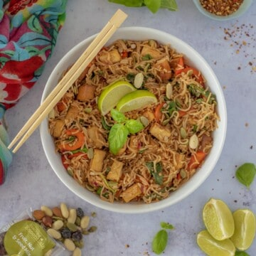 Rice Noodle Bowl with Crispy Tofu recipe which is fresh, quick, satisfying, lots of vegetables, and plenty of protein all ready in 30 minutes. Vegan and gluten free too! #healthyeatingrecipes #healthydinnerideas #vegandinners #healthyvegan #easyhealthyrecipes # cleaneatingrecipes #cleaneating #glutenfreedinner
