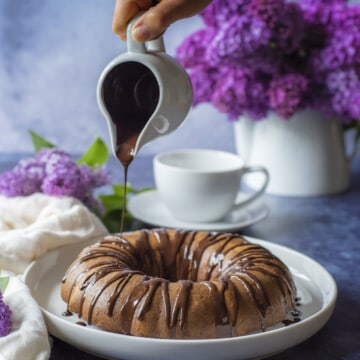 Melted chocolate and crushed nuts make this easy and healthy Bundt cake the perfect Sunday treat.