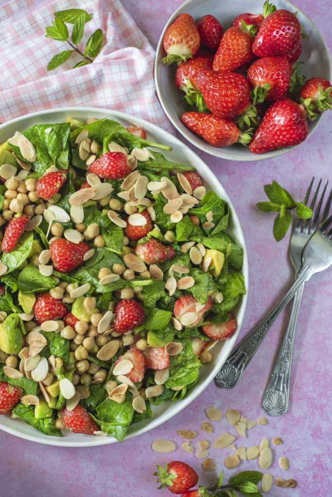 The best healthy salad recipe which combines all my favorite vegetables and fruit in one delicious bite. Serve with my orange dressing that ups the crunch! #healthysalad #strawberrysalad #vegansalad #glutenfreerecipes #summercooking #summerfood