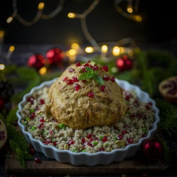 Whole roasted cauliflower with quinoa. So simple. So nutritious. So flavourful. So succulent with a perfect crunch and char. #vegan #veganchristmas #christmasrecipes # quinoa #christmasquinoa #healthychristmas