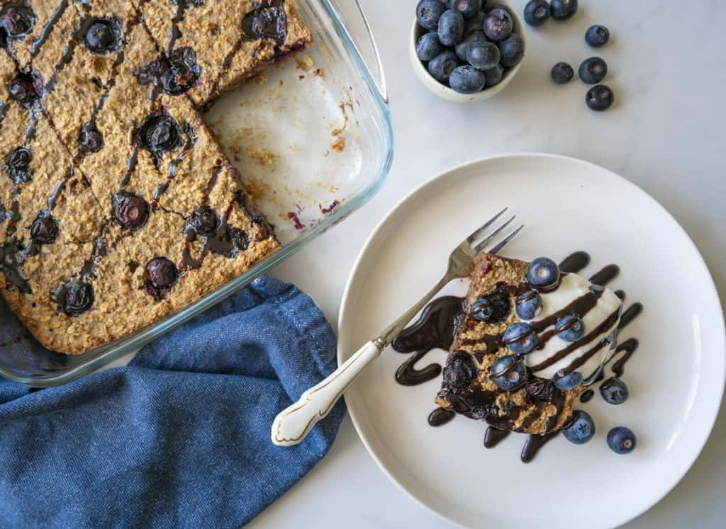 Healthy Baked Blueberry Oatmeal recipe which is easy, delicious and feeds the whole family. It will leave you satisfied all morning. Vegan & gluten-free too