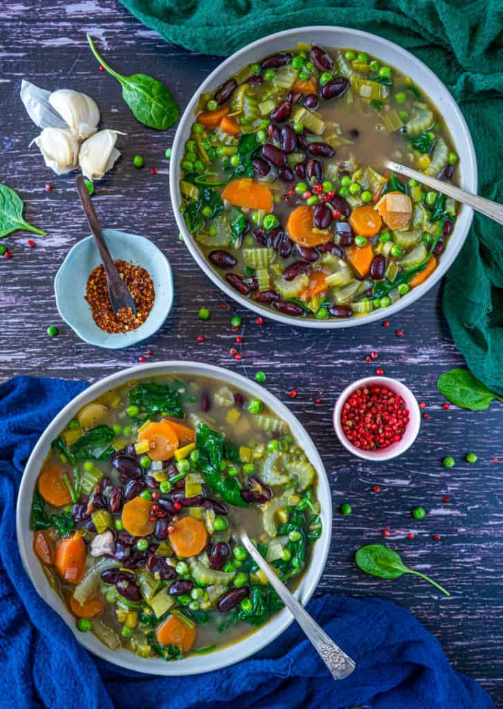 Healthy and easy vegetable soup recipe which is utterly delicious, hearty, filling, and soooo good for you. It happens to be vegan and gluten-free too! #veganrecipes #veganfood #vegandinner #veganlunch #glutenfree #cleaneatingrecipes #cleanvegan #healthysoup #healthydinner