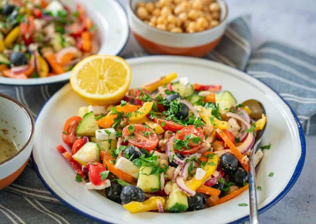 It's time for Easy Greek Salad Recipe. This simple Greek salad is filling, full of goodness and vibrant colours while being crunchy and one of my absolute favourite meals to have waiting for me in my fridge for either healthy lunch or dinner.