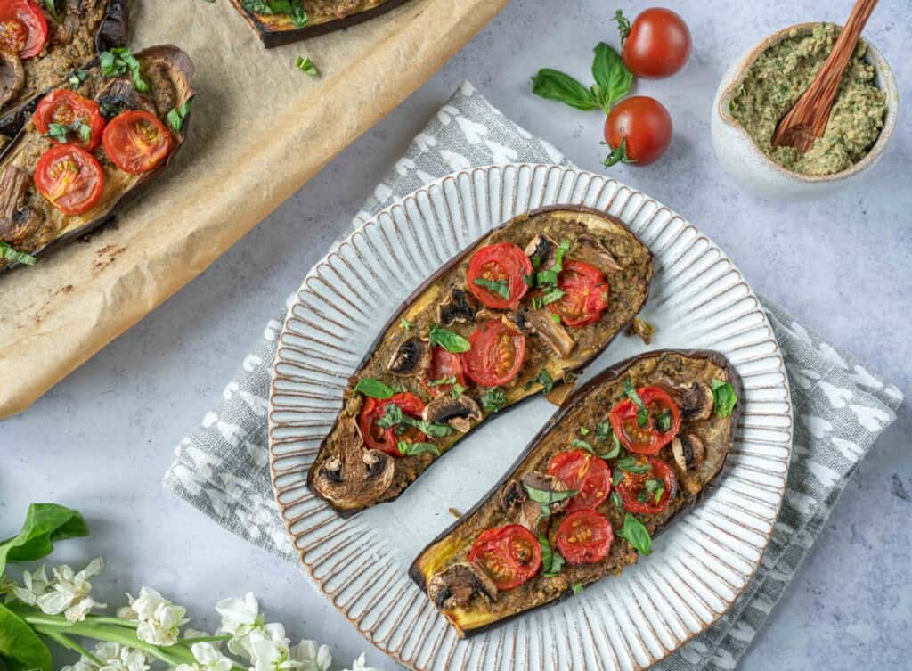 Aubergine Pizza with Pesto Hummus.which is a wonderful mid week lunch or dinner that packs a lot of vegetables, flavours and different textures.