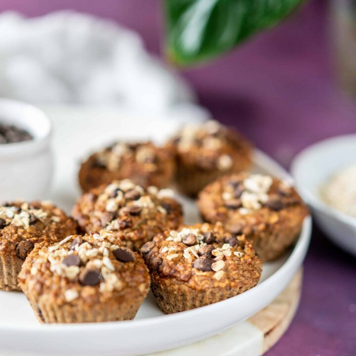 Fluffy, tender, healthy banana chocolate chip muffins made with oats, cinnamon, bananas, and a good handful of chocolate chips. They are insanely good!